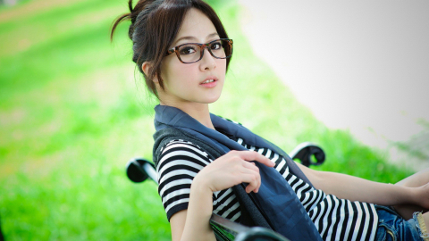 Beautiful Girl With Specs On Chair