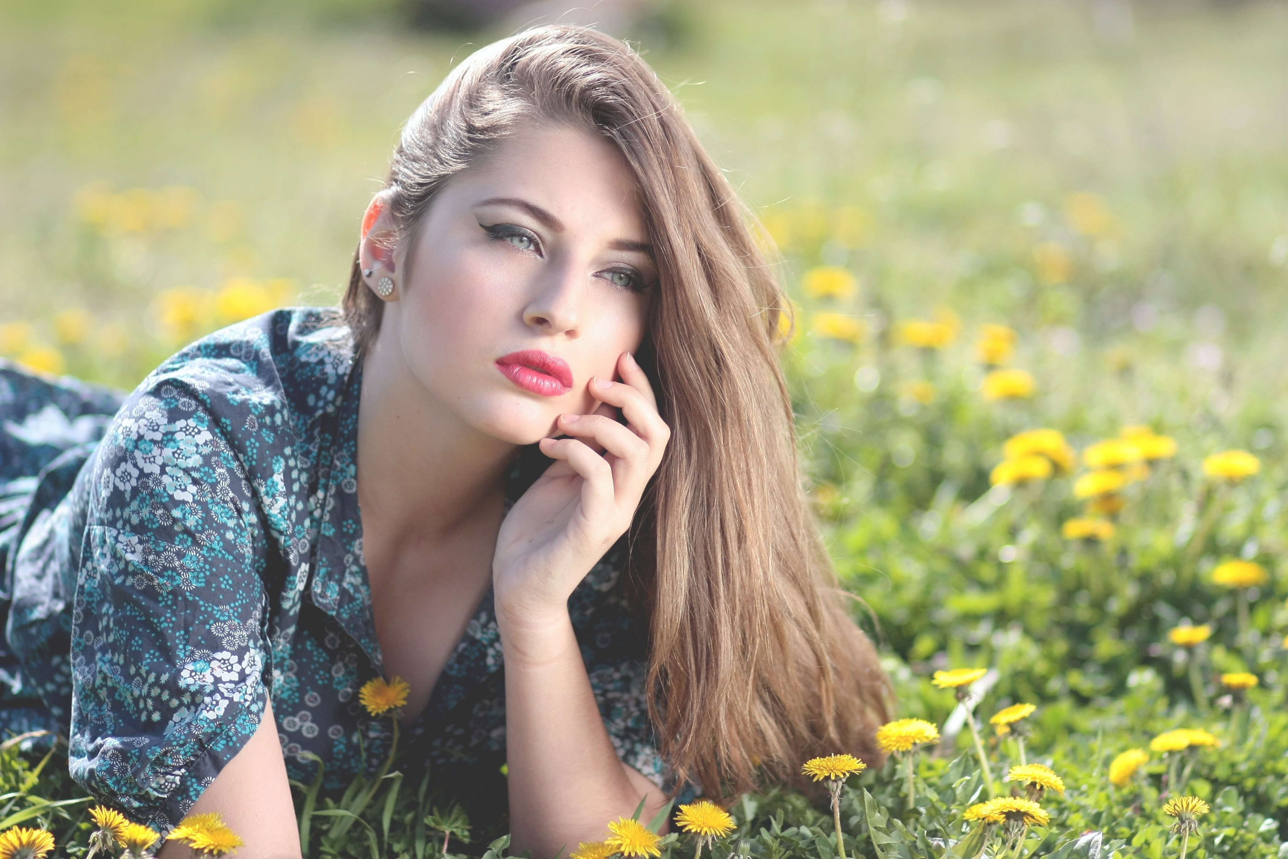 cute girl lying on yellow flower field during daytime
