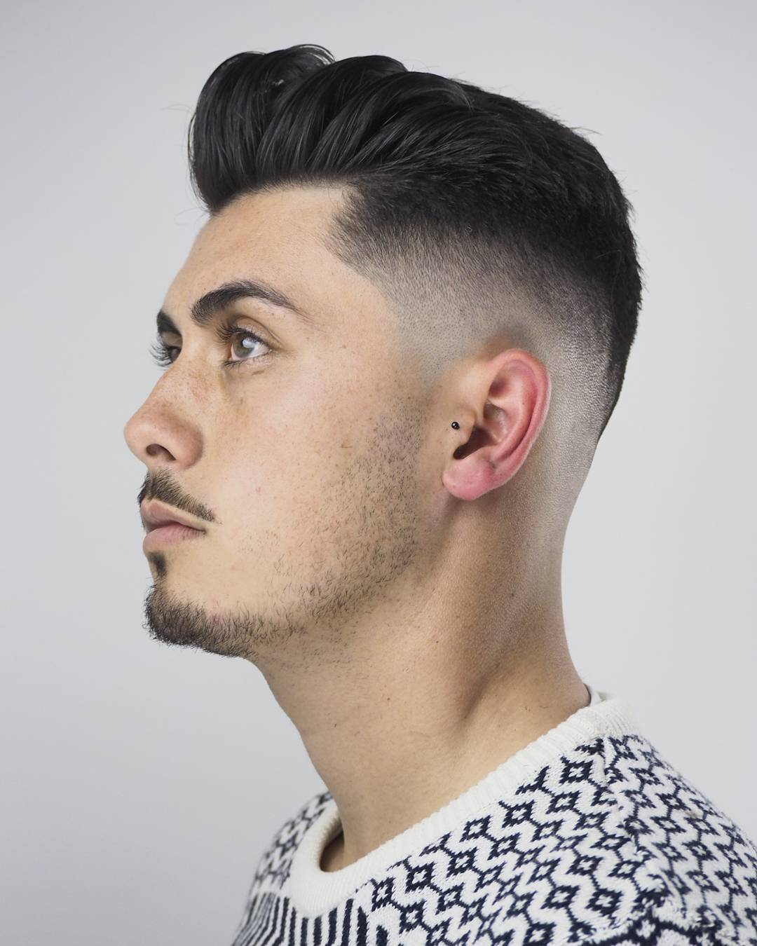 tapered fade with clean quiff